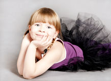Little girl lies and smiles Royalty Free Stock Photo