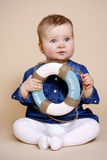 Little girl with lifebuoy Stock Image
