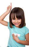 Little girl lifting a finger smiling Stock Images