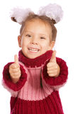 Little girl lifts forefingers upwards Stock Photo