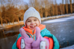 Little girl lifts thumbs up and laughing Royalty Free Stock Photography