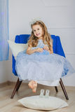 Little girl in light blue dress waiting Christmas Royalty Free Stock Photo