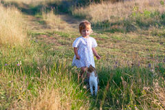 Little girl in the light dress with cat Stock Photo