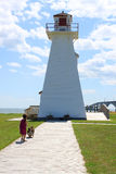 Little girl and lighthouse Stock Photo