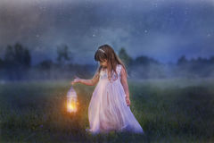 Little girl with lightning. Fairytale portrait of Little girl with lightning at the night field royalty free stock photos