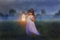 Little girl with lightning. Fairytale portrait of Little girl with lightning at the night field stock photos