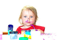Little girl and lilac paint Royalty Free Stock Images