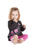 Little girl with lipstick Stock Photo