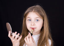 Little girl with lipstick Stock Photos