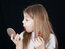 Little girl with lipstick Stock Image