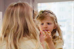 Little girl with lipstick Royalty Free Stock Photos