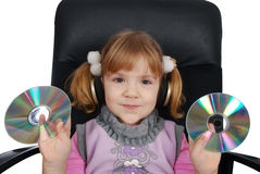 Little girl listen music Stock Images
