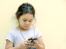 Little girl listen music with a MP3 player Stock Photography
