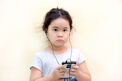 Little girl listen music with a MP3 player Stock Images