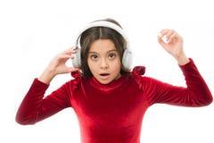 Little girl listen music wireless headphones. Online music channel. Girl little child use music modern headphones. Listen for free new and upcoming popular stock photography
