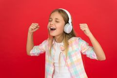 Little girl listen song headphones. Online radio station channel. Girl child listen music modern headphones. Get music stock photos