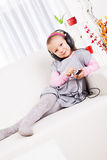 Little girl listening music Stock Image