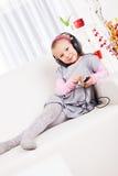 Little girl listening music Stock Image
