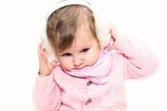 Little girl listening music in fur headphones Stock Photo