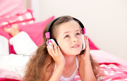 Little girl listening music with headphones Stock Photography