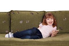 Little girl listening music on phone Stock Photography
