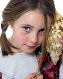 Little girl listening a shell Stock Photography