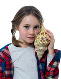 Little girl listening a shell Stock Photo