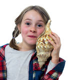 Little girl listening a shell Royalty Free Stock Photography