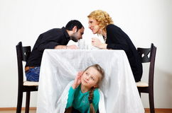 Little girl listening to the  adults secrets Stock Photos