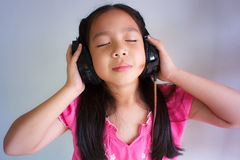 Little girl listening to music. Royalty Free Stock Photo