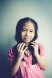 Little girl listening to music. Royalty Free Stock Photography