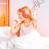 Little girl listening to music Royalty Free Stock Image