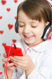 Little girl listening to the music Royalty Free Stock Photography