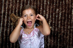 Little girl listening to music on headphones. Pretty little girl listening to music on headphones and cheering Stock Photo