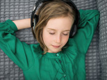 Little girl listening to the music. Royalty Free Stock Image