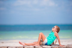 Little girl listening to music on headphones on the beach Royalty Free Stock Images