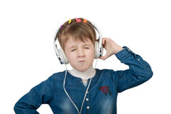 Little girl listening to music on headphones. Little girl listening to music loudly on headphones Royalty Free Stock Photography
