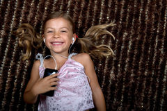 Little girl listening to music on an MP3 player Royalty Free Stock Image