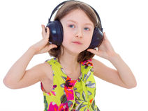 Little girl listening to music. Stock Photos