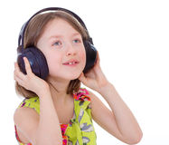 Little girl listening to music. Royalty Free Stock Photos
