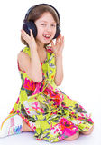 Little girl listening to music. Royalty Free Stock Image