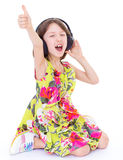 Little girl listening to music. Stock Photography