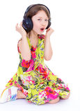Little girl listening to music. Stock Image