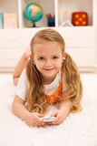 Little girl listening to portable music device Royalty Free Stock Image