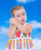Little girl listening to seashell Royalty Free Stock Image