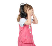 Little girl listens to music in big headphones and closed eyes Stock Image
