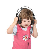 Little girl listens to music Royalty Free Stock Photo