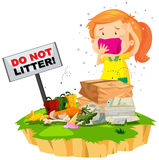 Little girl and litter pile Royalty Free Stock Images