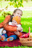 Little girl and little boy in autumn park Stock Photos