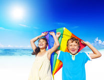 Little Girl And Little Boy Playing Kite Together By The Beach Royalty Free Stock Photos